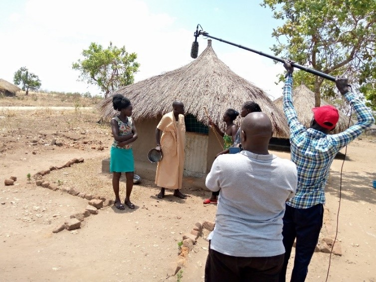 A drama scene recording in Imvepi Zone 1. (Husband and quarreling over the disappearance of the food given to them by the WFP.)