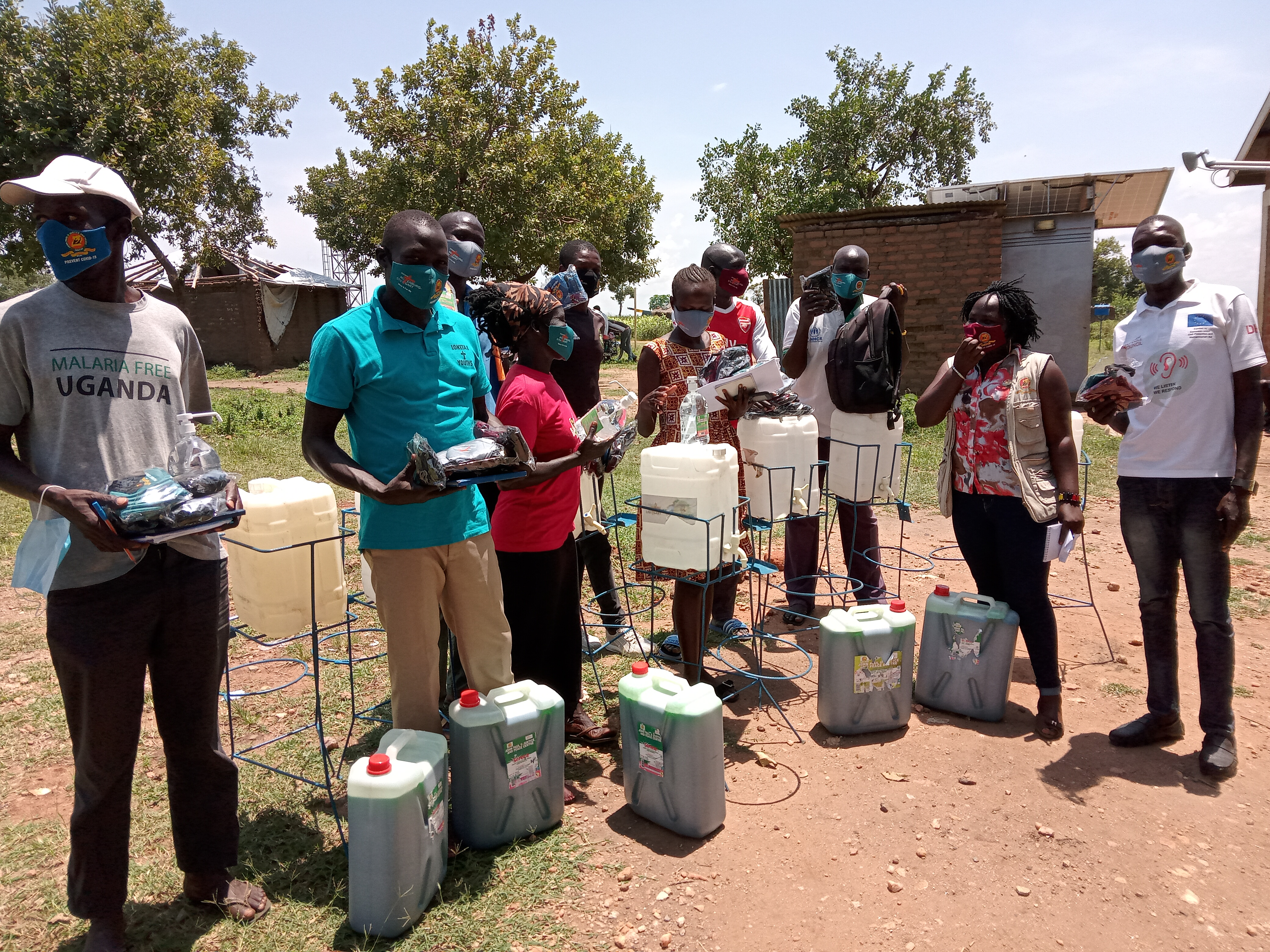 Refugee Welfare Councils (RWCs0 receiving reusable face masks, Sanitizers, liquid soap and hand washing facilities on behalf of their people
